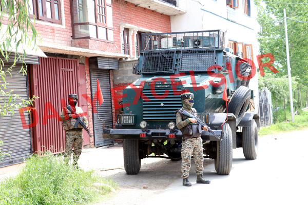 Security forces near encounter site at Pulwama on Saturday. -Excelsior/ Younis Khaliq
