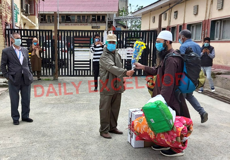 A Corona patient being discharged from the hospital after treatment in Srinagar on Monday. —Excelsior/Shakeel