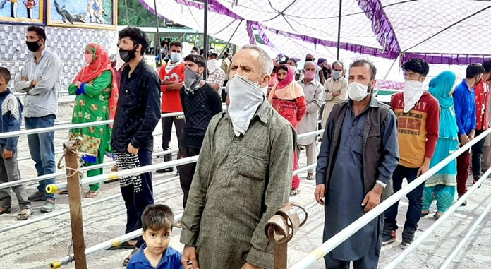 Long queues of people in Udhampur for sample testing on Tuesday.