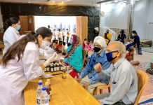 ISM doctors giving free immunity boosting medicines to people during a medical camp at Bahu Fort, Jammu.