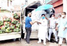 Former Minister Raman Bhalla distributing ration among needy in Gandhi Nagar Constituency.