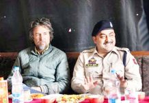 SP Traffic Ladakh Mohammad Rafi Giri interacting with different stakeholders at Kargil. -Excelsior/Basharat Ladakhi