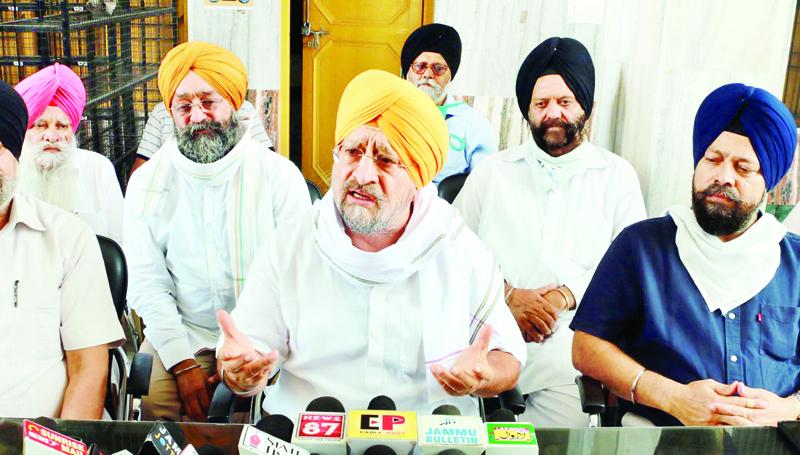 Chairman, J&K Gurdwara Parbandhak Board, Tarlochan Singh Wazir, addressing a press conference at Jammu.
