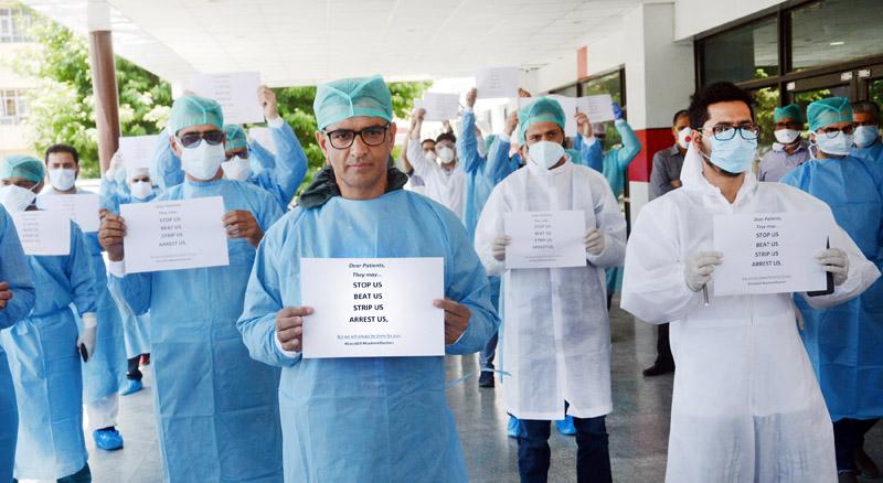 Doctors protesting at SSH Srinagar on Tuesday. -Excelsior/Shakeel