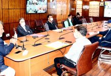 Principal Secy Transport, Asgar Samoon chairing a meeting at Srinagar on Monday.