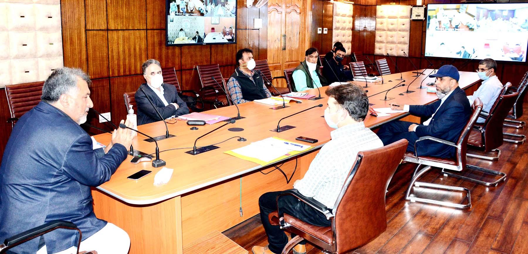 Principal Secy Transport, Asgar Samoon chairing a meeting at Srinagar on Monday.