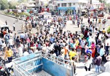 People staging protest at Satwari Chowk in Jammu on Monday. -Excelsior/Rakesh