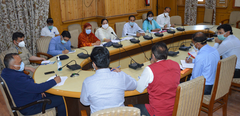 Divisional Commissioner P K Pole chairing a meeting at Srinagar on Thursday.