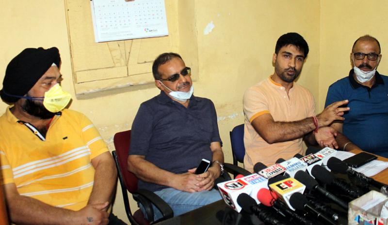 Power Employees Coordination Committee members talking to media in Jammu on Thursday. — Excelsior/Rakesh