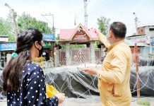Kashmiri Pandit pilgrims performing puja outside the main gate of Mata Kheer Bhawani Temple at Tulamulla in Central Kashmir on Saturday. -Excelsior/ Shakeel
