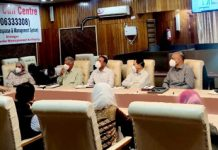 Deputy Commissioner Srinagar chairing a meeting on Wednesday.