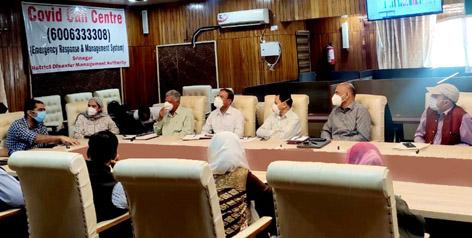 Deputy Commissioner Srinagar chairing a meeting on Wednesday.