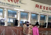Passengers standing in a queue outside a reservation counter at Railway Station.
