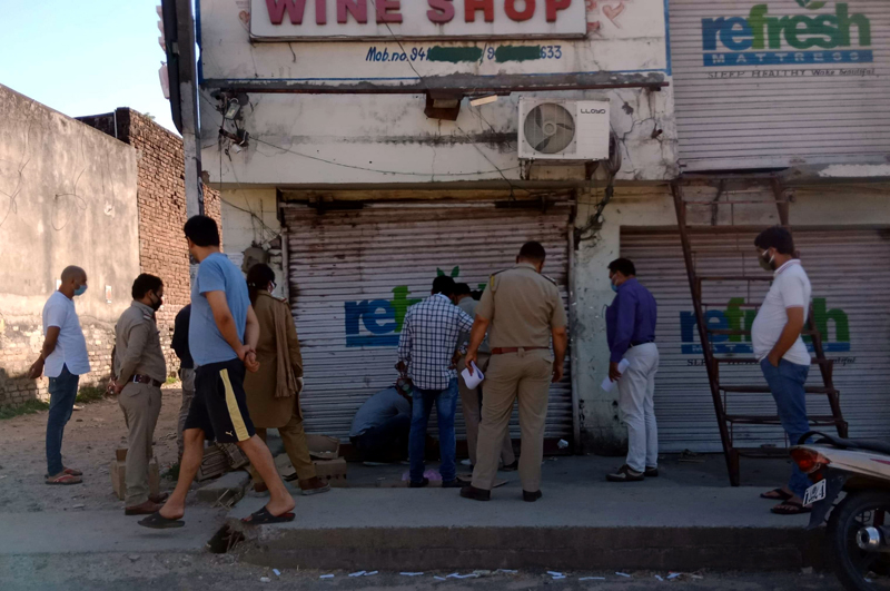 Sleuths of Excise Department sealing a wine shop in district Samba. — Excelsior/Badyal
