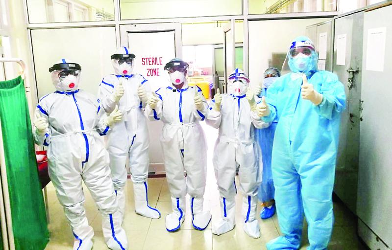 Corona warriors donning full PPE kits pose at Government Hospital, Gandhi Nagar, Jammu.
