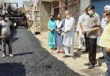 Former Deputy Chief Minister Kavinder Gupta kickstarting blacktopping of Rani Talab road on Tuesday.