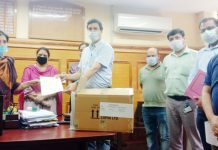 Officials of Lupin Ltd giving essential items to Director I&C Anoo Malhotra.
