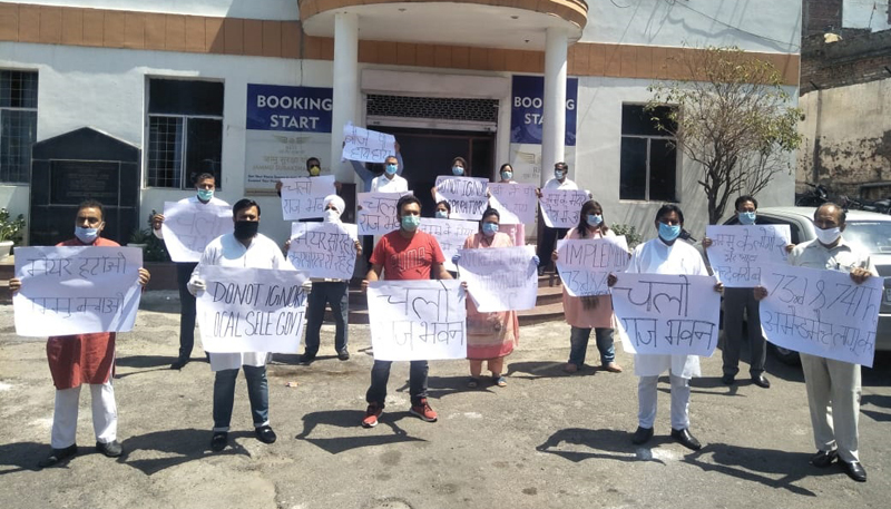 Congress and Independent Councilors of JMC during a protest demonstration at Jammu on Tuesday.