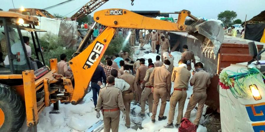 Police personal in rescue operation at accident site in Auraiya on Saturday. about 24 migrant workers killed in a collision between two truck, they coming from Delhi during nationwide lockdown in wake of COVID 19. (UNI)