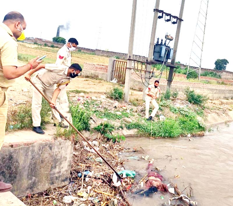 Police officials fishing out dead body of a woman from a canal in Gadigarh area of Jammu.