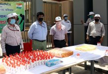 NHPC officials during distribution of personal hygiene kits.