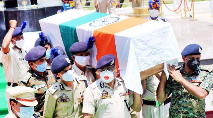 Director General of Police Dilbag Singh and other senior CRPF and police officials carrying the coffin of a CRPF jawan, who was martyred in an encounter with militants in South Kashmir's Pulwama district on Tuesday.(UNI)