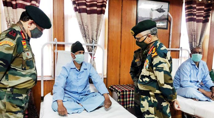 Army chief General M M Naravane interacting with a soldier at Military Hospital, Leh on Tuesday.(UNI)