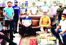 Members of J&K Archery Association posing for a group photograph along with office bearers of the Association in Jammu.