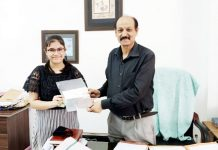 Winner receiving cheque of Rs 10000 from Senior Superintendent Post Office, JR Angural at his Jammu Office.