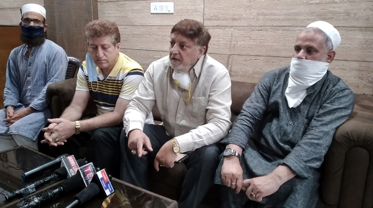 Old City Bussinessmen talking to media persons in Jammu on Saturday.