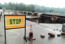 Portion of approach road to Birma bridge on old NH breaches due to heavy rain in Udhampur on Saturday. —Excelsior/ K Kumar