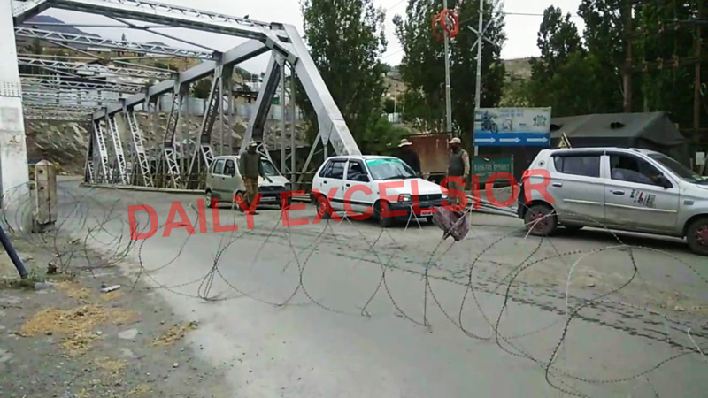Kargil town being fenced again following re-imposition of lockdown like restrictions in Ladakh on Saturday. -Excelsior/Basharat Ladakhi