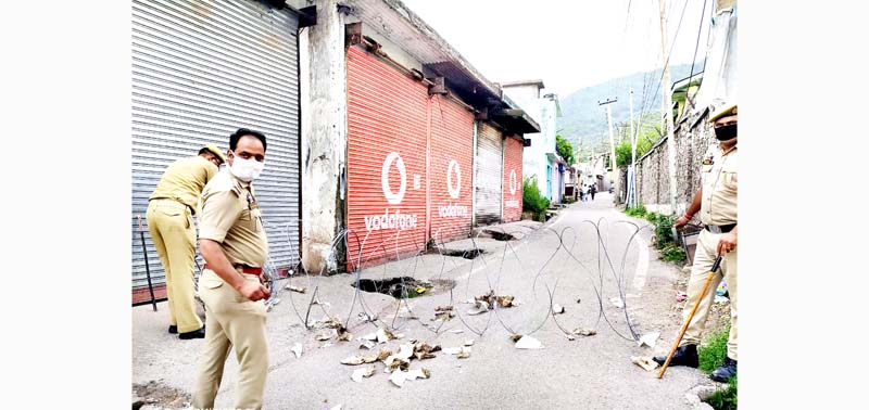 A road in Poonch being sealed by police after being declared as Containment Zone on Wednesday. -Excelsior/Gurjeet Bhajan