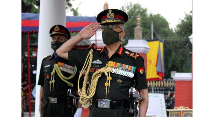 Chief of the Army Staff, General M M Naravane reviewing the passing out parade at Indian Military Academy, in Dehradun on Saturday. (UNI)