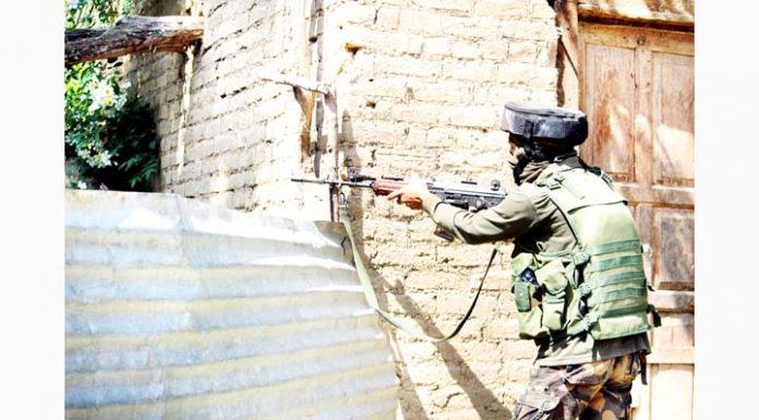 An Army soldier takes position during encounter at Shopian on Wednesday. -Excelsior/Younis Khaliq