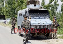 Security forces near encounter site at Kangan, Pulwama on Wednesday. -Excelsior/Younis Khaliq