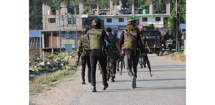 Troops rush to the site of encounter at Shopian on Tuesday. — Excelsior/Younis Khaliq