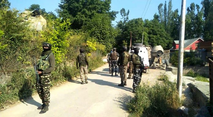 Troops at the site of encounter at Meej, Pampore on Thursday. —Excelsior/Younis Khaliq