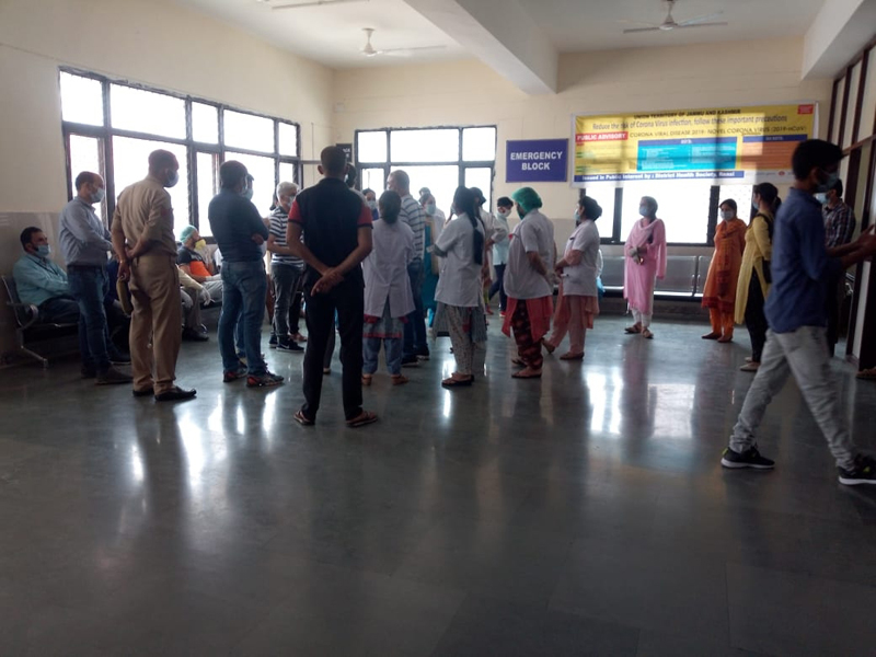 Medical staff assembles in DH Reasi after a patient turns Corona positive on Tuesday. — Excelsior/Romesh Mengi