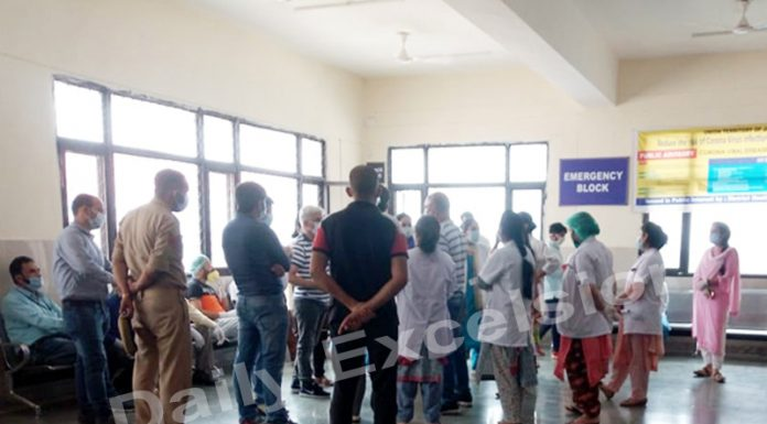 Medical staff assembles in DH Reasi after a patient turns Corona positive on Tuesday.— Excelsior/Romesh Mengi