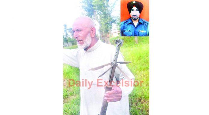 Villager shows remains of mortar shell in Balakote sector of Mendhar on Thursday. (Inset) Martyr Naik Gurcharan Singh. —Excelsior/Rahi Kapoor