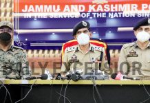 Police and CRPF officers at a joint press conference in Srinagar on Sunday. -Excelsior/Shakeel