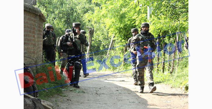 Security forces near the encounter site at Pinjura, Shopian on Monday. -Excelsior/Younis Khaliq