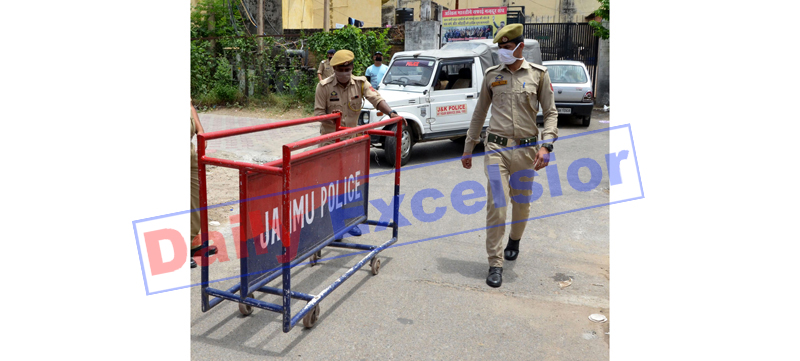 Dogra Hall sealed by police after being declared as Containment Zone on Sunday. — Excelsior/Rakesh