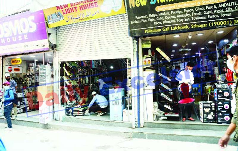 Shops open amid lockdown in Srinagar on Monday. -Excelsior/Shakeel
