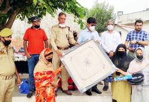 Officials of District Legal Services Authority handing over Carrom Board to jail inmates in Rajouri.