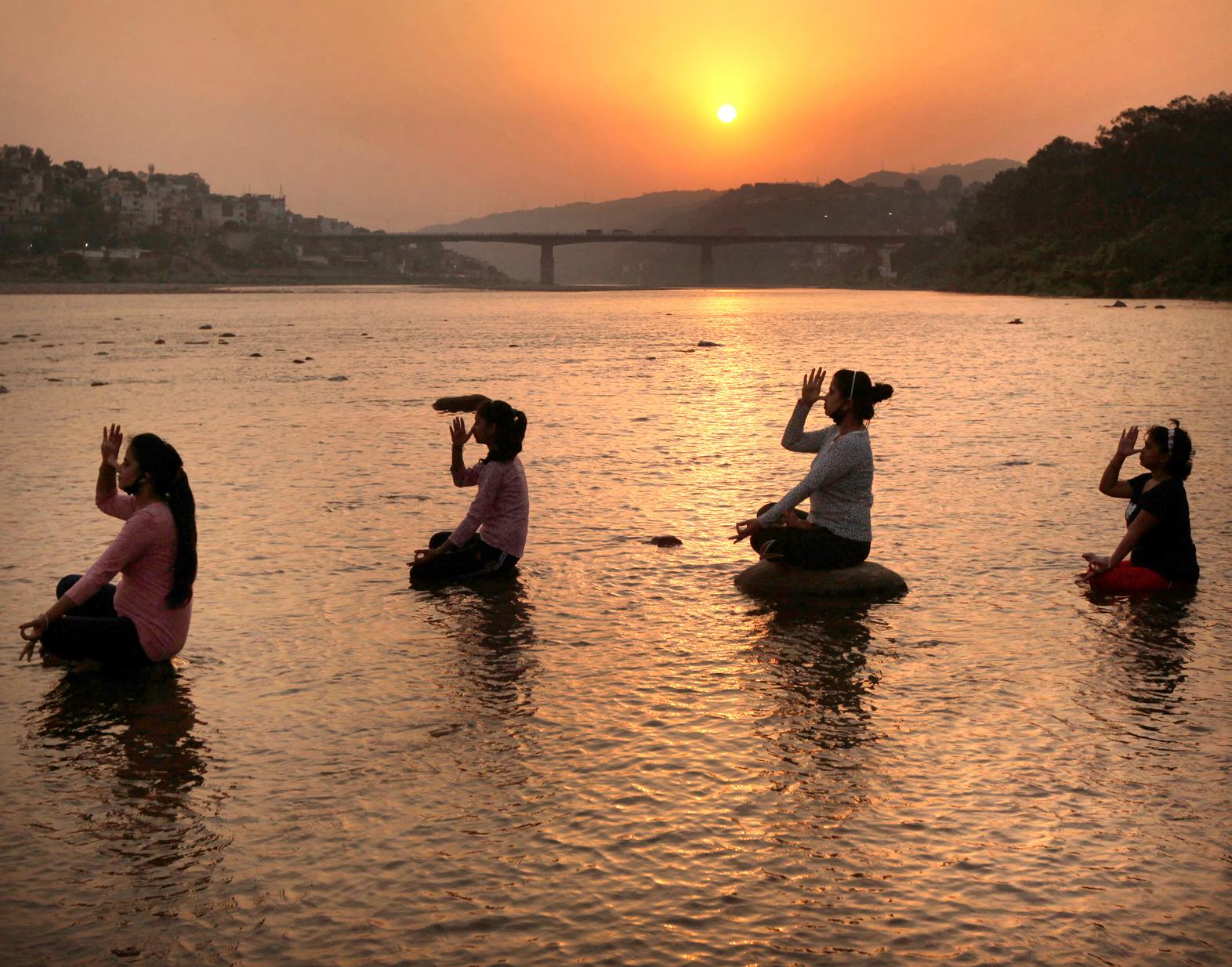 People performing yoga on International Yoga Day in Jammu. — Excelsior/Rakesh