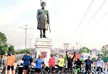 Cyclists being flagged off for group rides to create awareness among people about benefits of cycling.