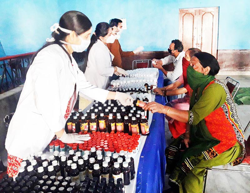 ISM doctors providing immunity boosting medicines to patients during a medical camp in Jammu.