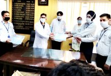 SBI officers handing over PPE kits and masks to Dr LD Bhagat, MS, COVID Hospital, Gandhi Nagar, Jammu.